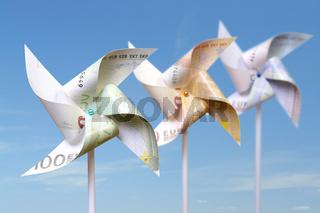 Three toy windmills cut from 100