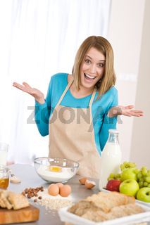 Baking - Surprised woman prepare fresh ingredients for healthy cake