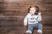 Baby boy listen music with headphones