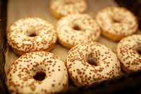 close up of donuts at bakery or grocery store
