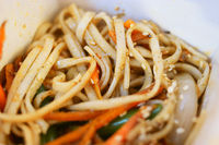 Asian fast food. fryed noodles in open take away box