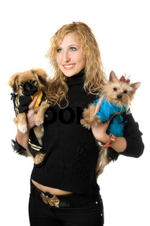 Portrait of cheerful young blonde with two dogs. Isolated