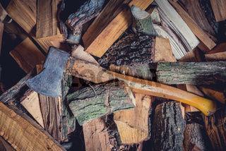 axe over pile of wood