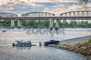 Missouri River and motor boat at a ramp