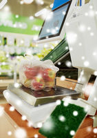 apples in plastic bag on scale at grocery store