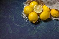 Fresh lemons stacked on burlap sack