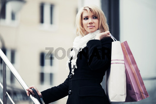 Fashion young woman with shopping bags