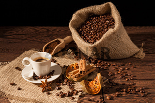Coffee cup with cinnamon, star anise and dried orange fruit