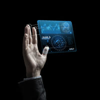 businessman hand with virtual charts over black