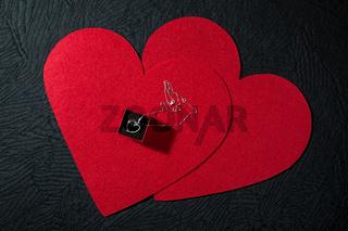 Silver heart pendant on two red heart felts