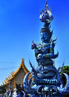 Statue at Wat Rong Seua Ten or the Blue Temple