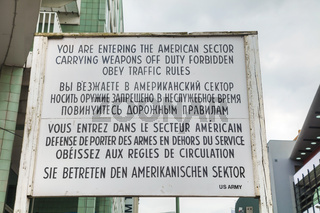 Historical sign at Checkpoint Charlie in Berlin