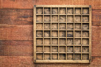 vintage typesetter case on rustic wood
