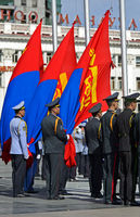 Officers of the Mongolian armee with the national flag during the preparations for a parade