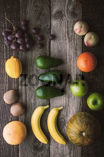Different fruit on the wooden table top view