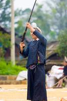 Biasha Miao Minority Man Shooting Gun Hair Bun