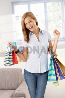 Happy woman with shopping bags in hands