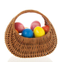 Wicker basket colorful easter eggs