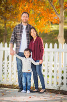 Outdoor Portrait of Mixed Race Chinese and Caucasian Parents and Child.