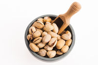 bowl of pistachios on white background