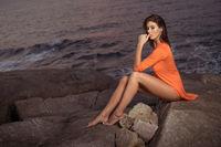 Pretty woman on the rocks