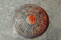 Manhole closed in the street above view.