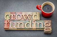 crowdfunding word in wood type