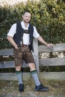 a man in bavarian traditional cloth