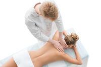 Nude blonde being massaged top view