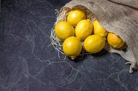 Lemons spilling from a hessian sack