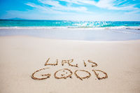 Life is good text on sandy beach