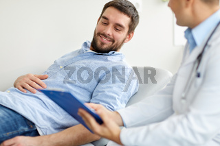 doctor and man with health problem at hospital