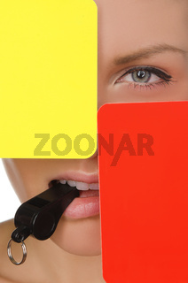 beautiful woman, red and yellow soccer referee and whistle