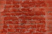 Old red brick wall painted in two different tones