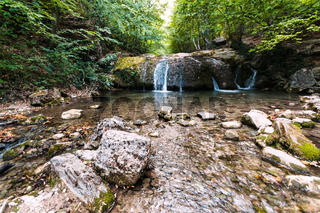 small waterfall on Ulu-Uzen river in Haphal Gorge