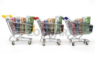 Three Shopping carts with money in a row