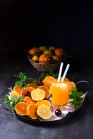 Orange lemonade with lemon and mint