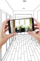 Hands Holding Smart Phone Displaying Photo of House Hallway Drawing Behind