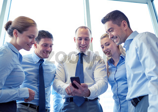 happy businesspeople with smartphone