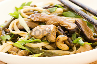 Thai chicken curry with mushrooms and noodles
