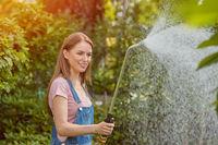 Gardeners watering plants