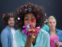 confetti party multiethnic group of people isolated over gray