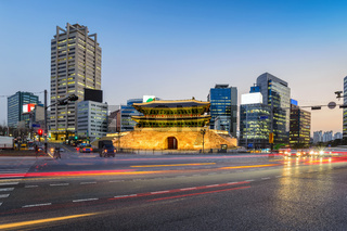 Namdaemun Gate and city skyline at night, Seoul, South Korea