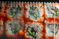 Japan sushi in packaging box top view, drops of water on inner side of plastic cover