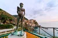 The Lady of the Grapes statue in Manarola