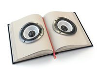 Audiobook or e-learning concept. Open book with loudspeakers on the pages.