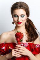 beautiful girl with fresh strawberries