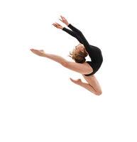 Young slim gymnast in gracefull jump studio shot