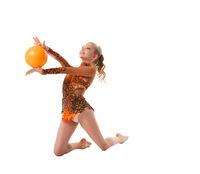 Young slim gymnast with yellow ball studio shot