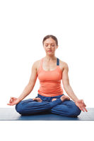 Woman meditating in yoga asana Padmasana Lotus pose